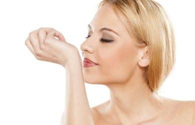 Pretty woman smelling lemongrass